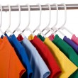 Colorful T-Shirts on White - Stock Photo