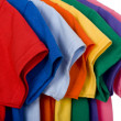 Colorful T-Shirts on White — Stock Photo #13643463