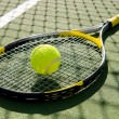 Постер, плакат: Tennis Racket and Ball on Court