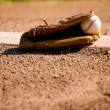 Baseball Glove and Ball on Pitcher&#039;s Mound - Stock Photo