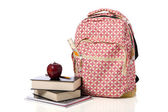 Pink Patterned Back Pack with supplies and an apple — Stock Photo
