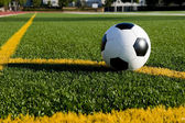 Soccer ball or football on a field — Stock Photo