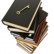 Huge stack of books with a skeleton key on top — Stock Photo