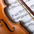 Stock Photo: Violin and bow on music