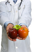 Doctor encouraging Apples — Stock Photo