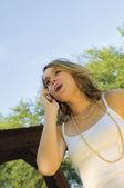 Pretty Teenage Girl talking on mobile phone — Stock Photo