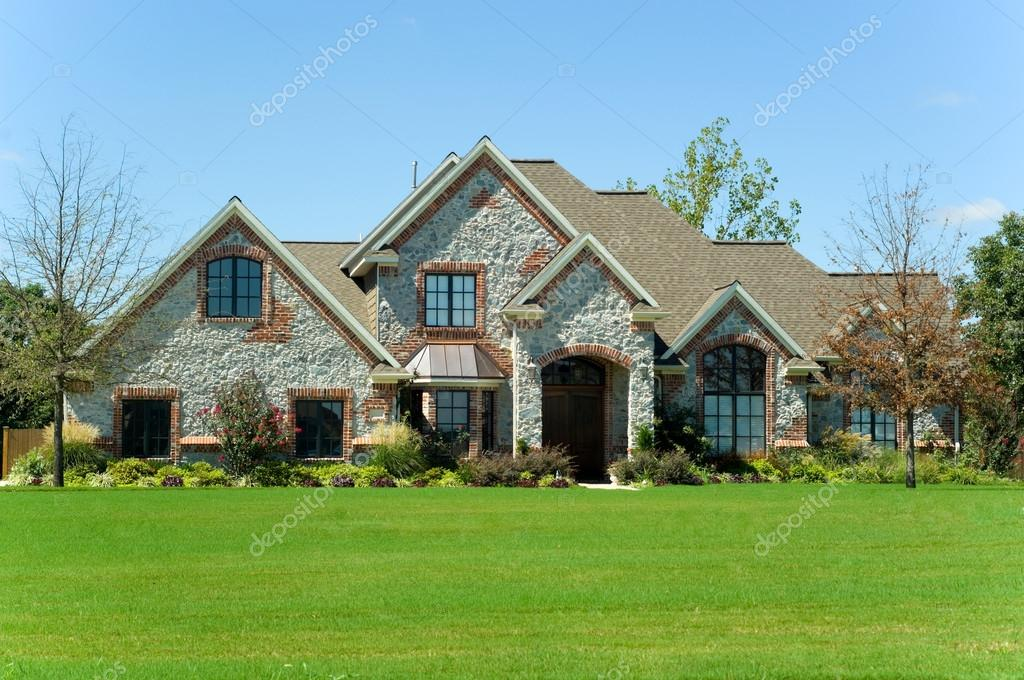 Beautiful two story home, real esate or property with landscaped lawn against a blue sky - construction industry — Stock Photo #13929735