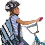 Girl riding Bike to School — Stock Photo