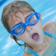 Little Girl taking Big breath in swimming pool — Stock Photo