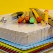 School Supplies on yellow background — Stock Photo #13930261
