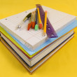 School Supplies on yellow background — Stock Photo