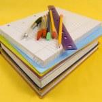 School Supplies on yellow background — Stock Photo