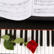 Sheet Music with Rose on piano — Stock Photo