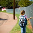 Young girl walking to school on first day of school — Stock Photo