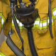 Fire protective suit with gasmask — Stockfoto