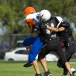 Stock Photo: AmericFootball - Youth - Tackle!