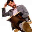 Bearded male student reading book  - expressing confusion — Stok fotoğraf