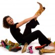 Pretty young, attractive lady trying on shoes — Stock Photo