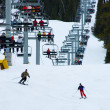 Busy snow ski resort with chairlift — Stock Photo
