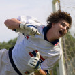 Soccer Football Goal Keeper straining for Save — ストック写真