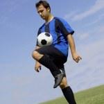 Football - Soccer Player Juggling — Stock Photo