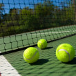 Tennis balls on Court — Stock Photo