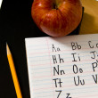 Stock Photo: Alphabet on desk