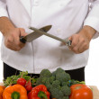 Chef - man sharpening knife — Stock Photo