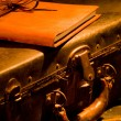 Постер, плакат: Old vintage leather suitcase with leather bound journal on top