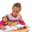 Young Girl at desk in school on white — Stock Photo #13932345