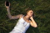 Pretty Teenage Girl listening to portable music player — Stock Photo