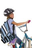 Bicicleta de niña a caballo a la escuela — Foto de Stock