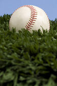 Baseball on Grass with blue sky — Stock Photo