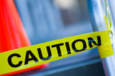 Caution tape with orange traffic cone — Stock Photo