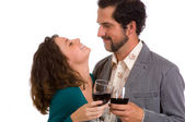 Happy Young Couple - enjoying a glass of wine — Stock Photo