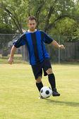Fútbol - Jugador del balompié de goteo — Foto de Stock