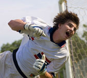 Soccer Football Goal Keeper straining for Save — Stock Photo