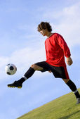 Soccer - Football Player Juggling in Red — Stock Photo