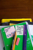 School books and supplies on desk — Stock Photo