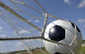 Football - Soccer ball in Goal — Stock Photo