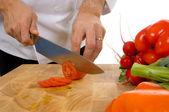 Professional chef slicing tomato — Stock Photo