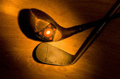 Antique, vintage golf clubs painted with light — Stock Photo