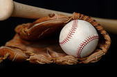 Baseball and Bat and Glove on black — Stock Photo
