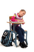 Young Girl at desk in school on white — Stock Photo