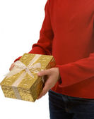 Young girl in red with gold Christmas present — Stock Photo