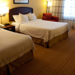 A nice hotel room interior with two beds — Stock Photo
