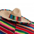 Serape and sombrero on a white background - 图库照片