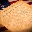 United States Declaration of Independence on flag background — Stock Photo #13988221