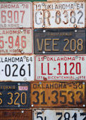 Group of old vintage American license plates — Stock Photo