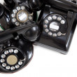 A group of vintage telephones on a white background — Stock Photo #18578461
